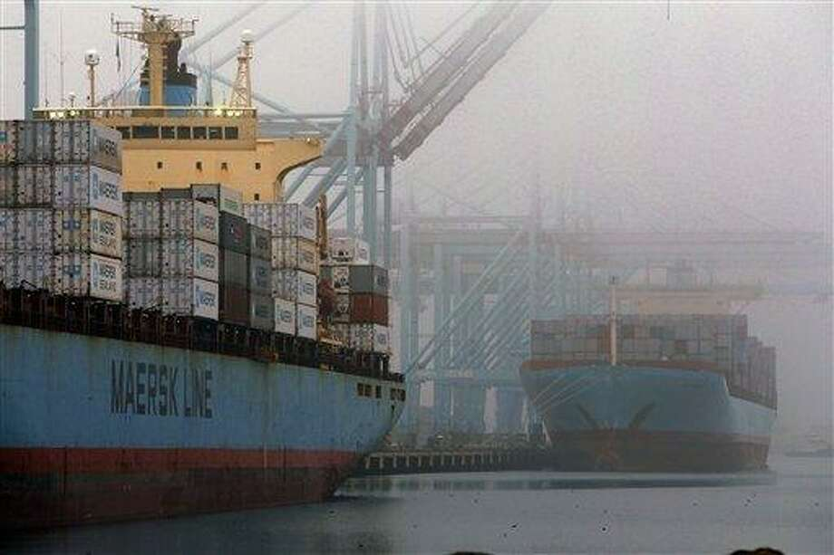 In this Wed. Dec. 5, 2012, photo, containers are unloaded from cargo ships at  the Port of Los Angeles. Most economists agree that the snapshot of U.S. economic growth released Wednesday, Jan. 30, 2012, is going to look dismal. (AP Photo/Nick Ut) Photo: AP / AP