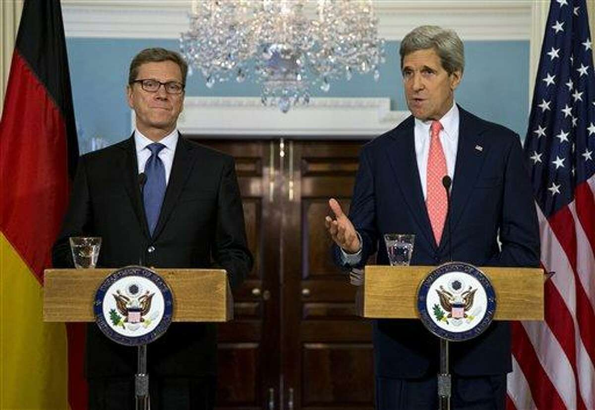 Secretary of State John Kerry, right, gestures as he speaks during a news conference with German Foreign Minister Guido Westerwelle at the State Department in Washington, Friday, May 31, 2013. The U.S. and Germany say Russia must not provide the Assad regime of Syria with an advanced air defense system that they believe could prolong Syria's civil war. (AP Photo/Evan Vucci)