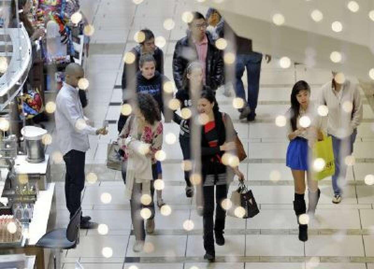 Shoppers walk through the International Mall Friday, Nov. 23, 2012, in Tampa, Fla.