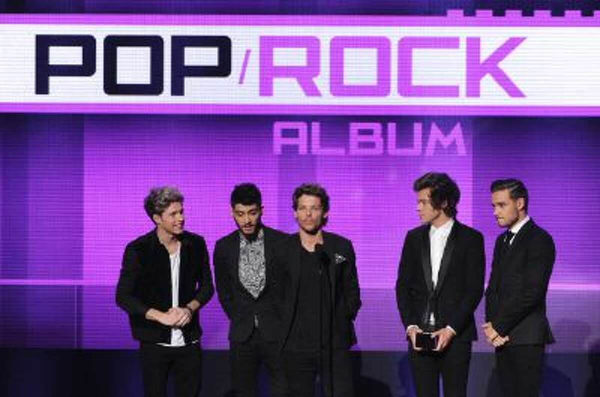 (L-R) Niall Horan, Zayn Malik, Louis Tomlinson, Harry Styles and Liam Payne of One Direction accept the Favorite Pop/Rock Album award for 'Take Me Home' onstage during the 2013 American Music Awards at Nokia Theatre L.A. Live on November 24, 2013 in Los Angeles, California.