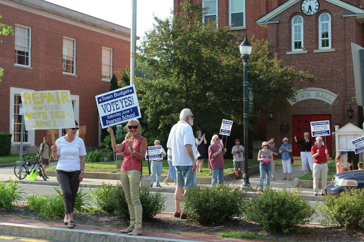 JASON SIEDZIK/ Register Citizen Residents gathered Friday afternoon outside of Winchester Town Hall to rally in support of the proposed budget.