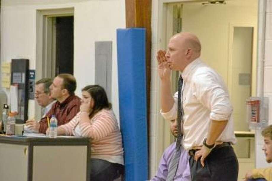 Keith Lipinsky coaches his team through a transition play. Pete Paguaga/Register Citizen.