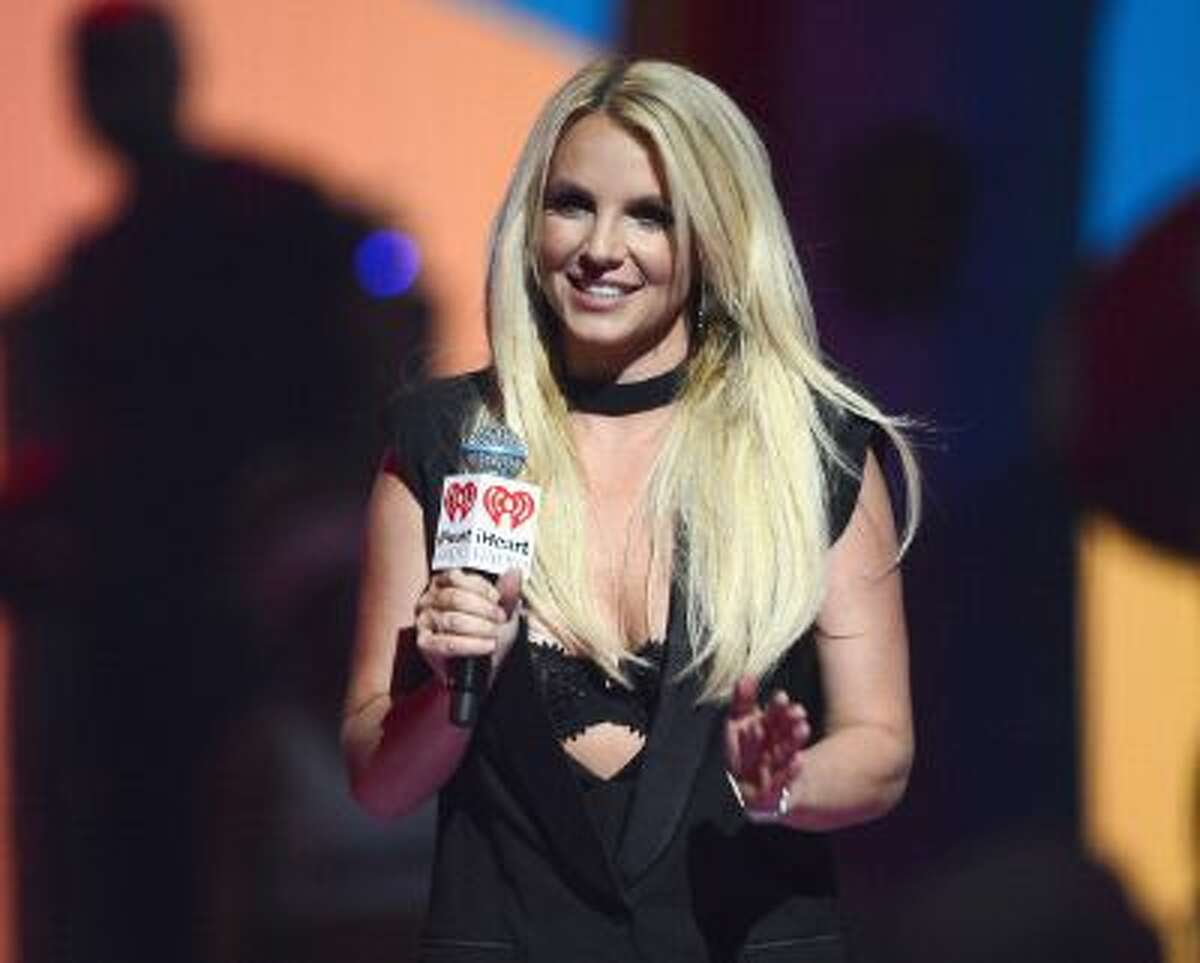 Britney Spears introduces a performance by Miley Cyrus during the iHeartRadio Music Festival at the MGM Grand Garden Arena on Sept. 21, 2013 in Las Vegas, N.V.