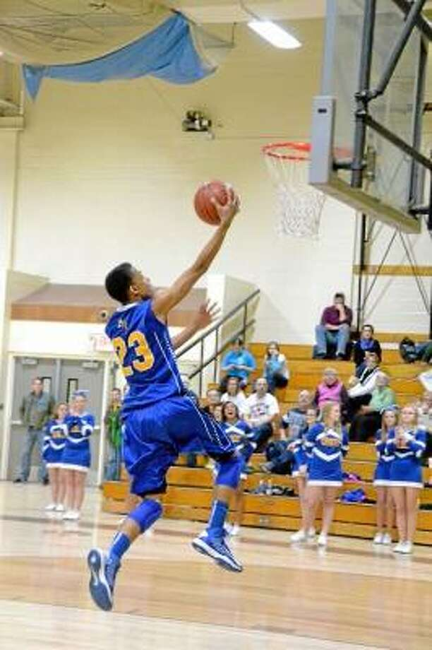 Robert Skinner currently has 1,458 career points and is 185 from breaking Gilbert's school record. Pete Paguaga/Register Citizen.