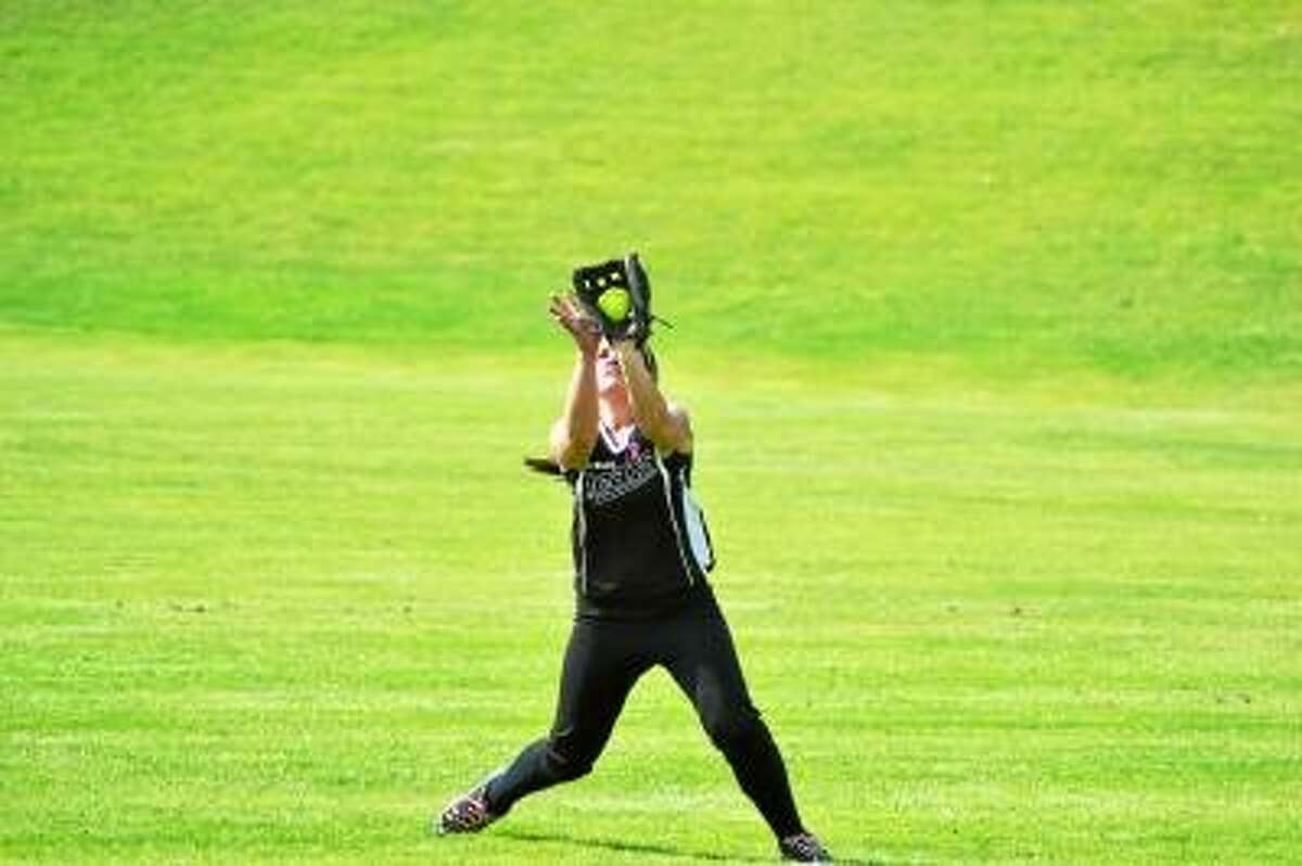 Pete Paguaga/Register Citizen \Thomaston's Erin O'Neil catches a fly ball in right field.