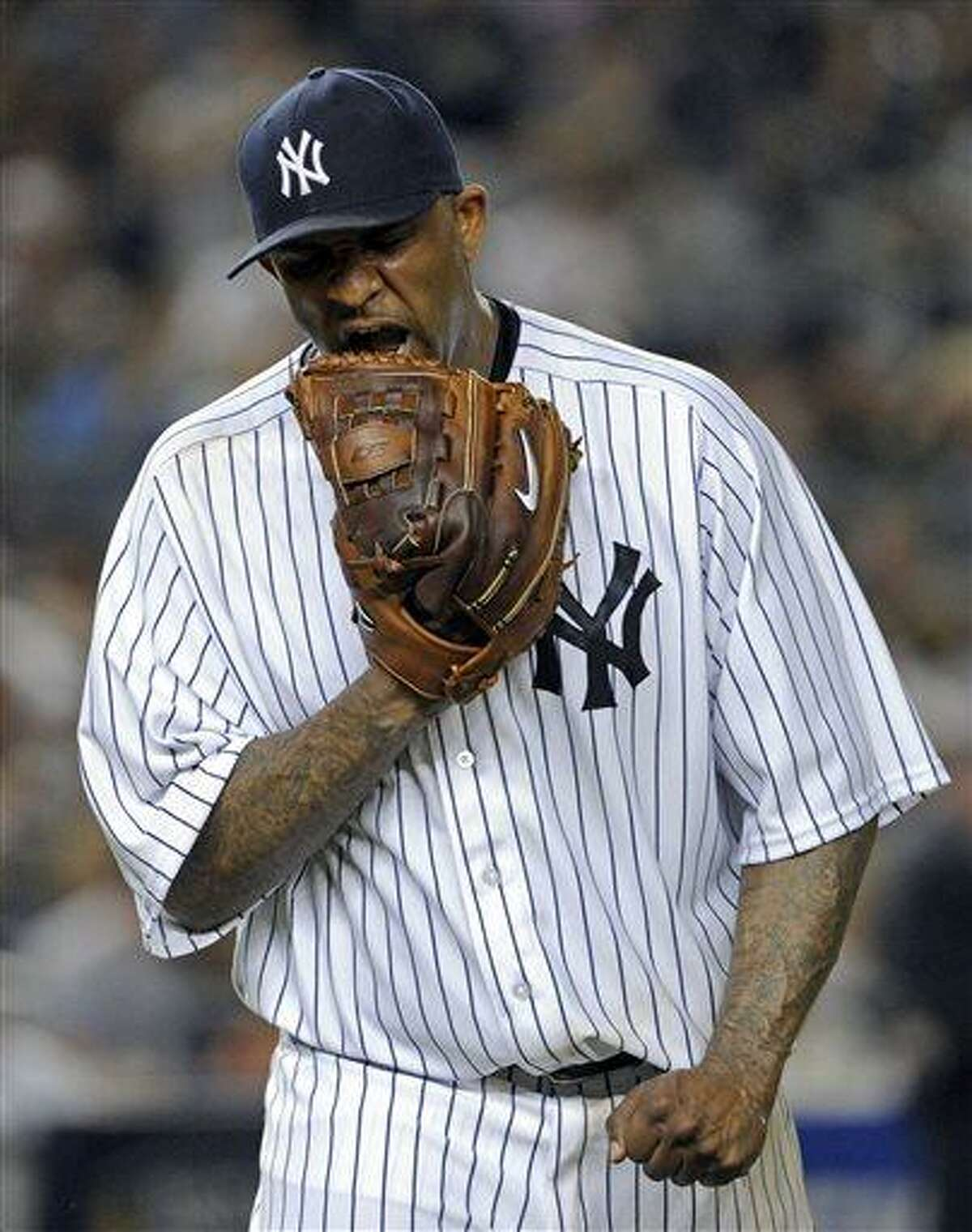 New York Yankees pitcher CC Sabathia leaves the field after allowing a run during the seventh inning of a baseball game against the Boston Red Sox, Friday, May 31, 2013, at Yankee Stadium in New York. (AP Photo/Bill Kostroun)