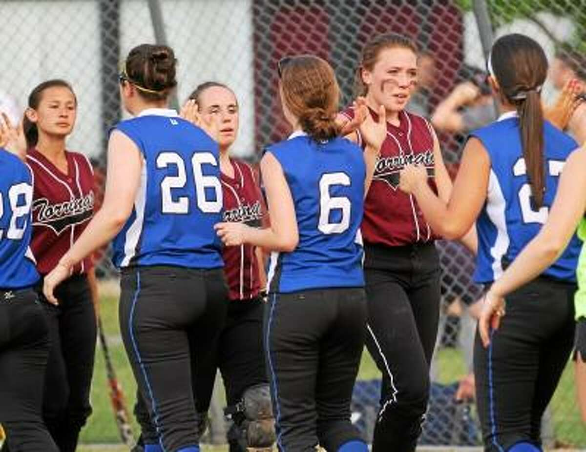 Marianne Killackey/Special to the Register Citizen Lady Raiders (left to right) Aunchlee Reilly, Marissa Morris, and Sara Heath congratulate Bunnell players after the game.