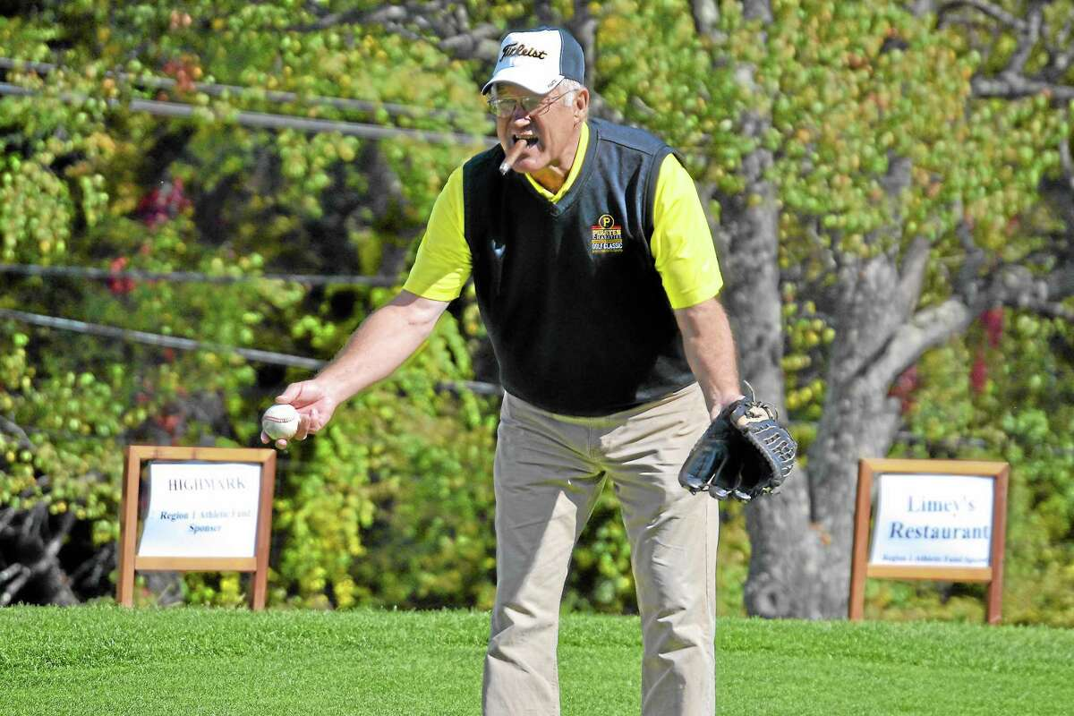 Steve Blass throws out the ceremonial first pitch to start the golf tournament.