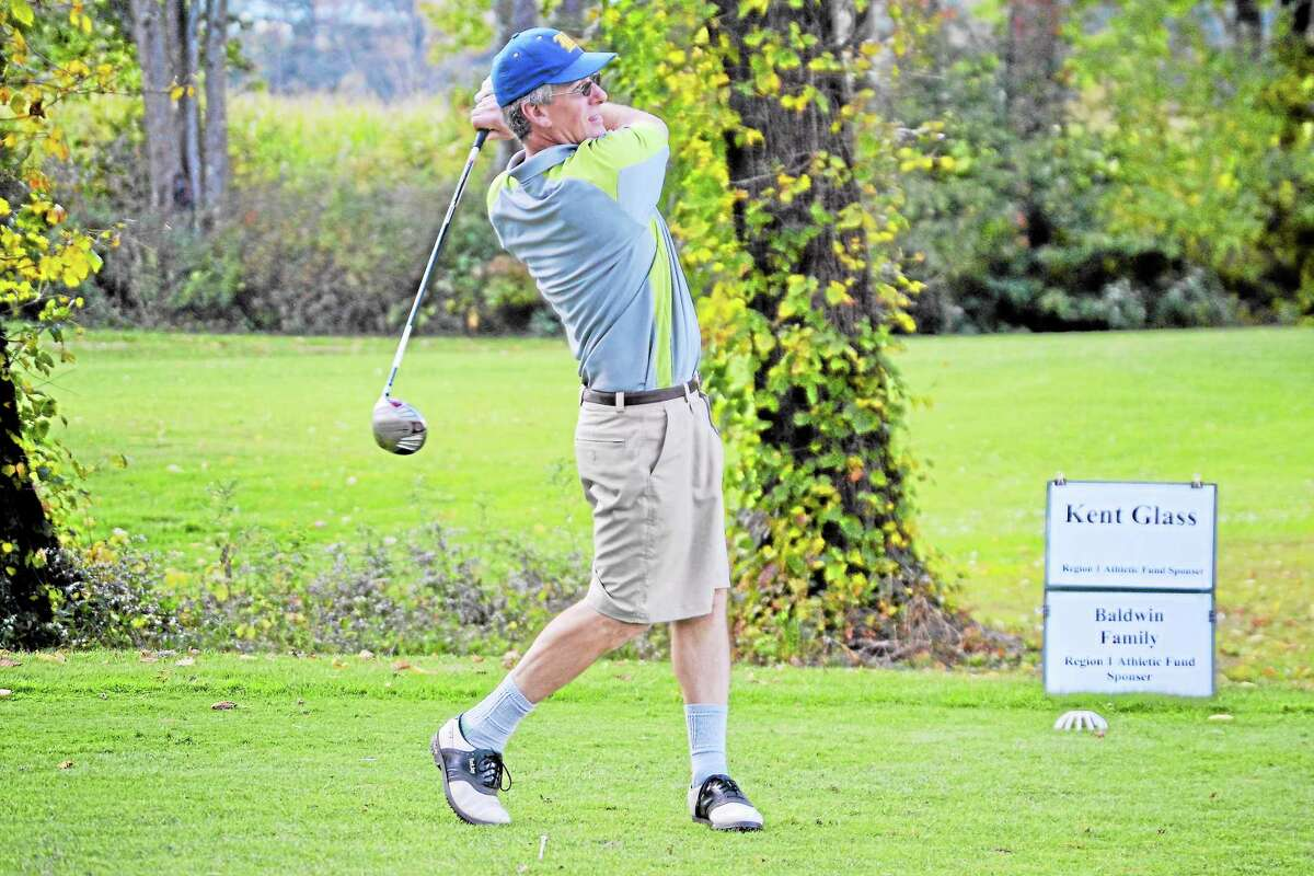 Champ Perotti, who helped put the tournament together, tees off during the Steve Blass Golf Tournament.