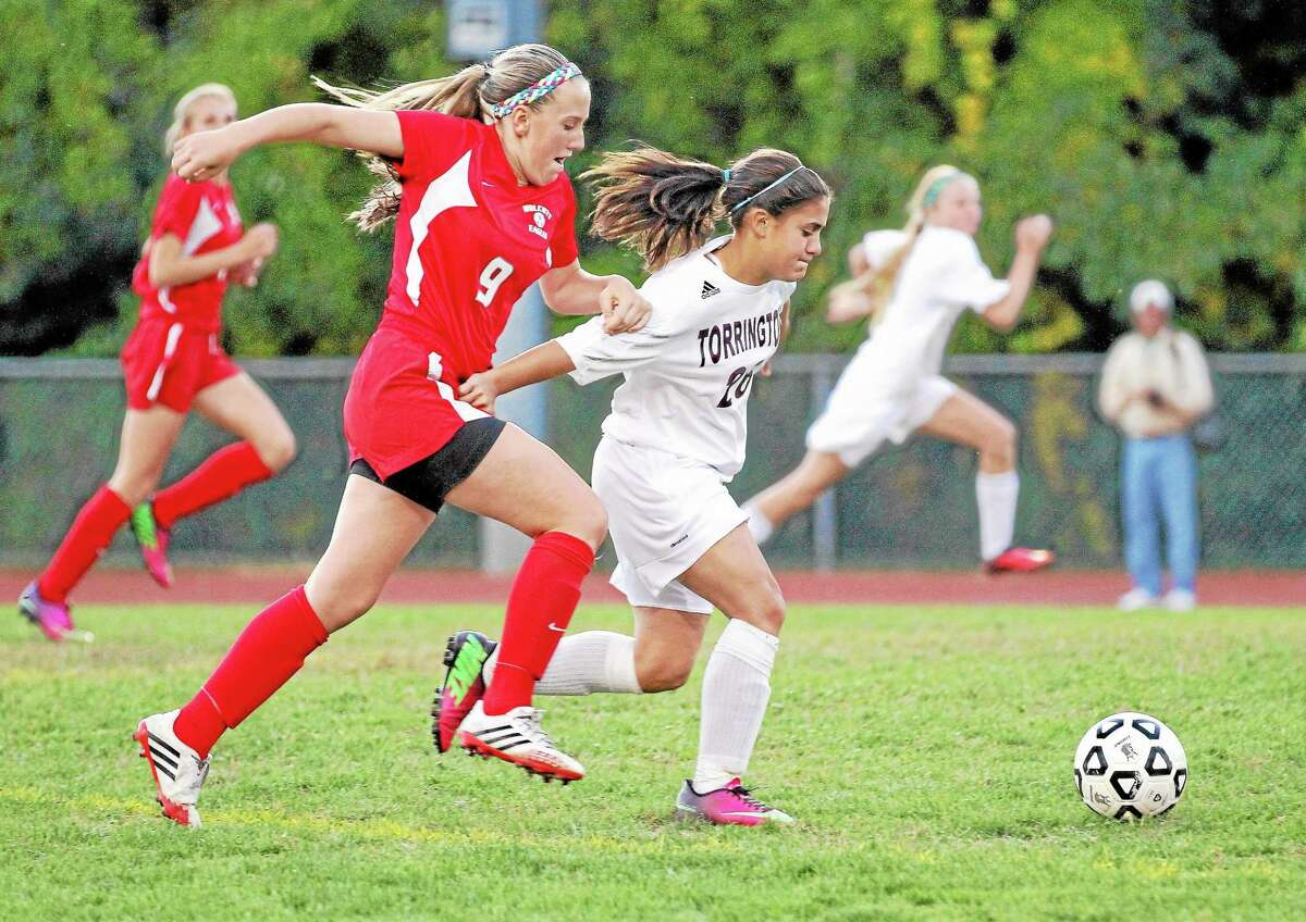 Marianne Killackey — Special to the Register Citizen Torrington's Alexis Tyrrell races Wolcott's Meghan Doubleday for control of the ball. Tyrrell went on to score two goals in her team's 4-0 win.