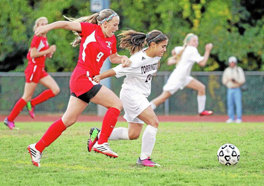 Marianne Killackey — Special to the Register Citizen Torrington's Alexis Tyrrell races Wolcott's Meghan Doubleday for control of the ball. Tyrrell went on to score two goals in her team's 4-0 win. Photo: Journal Register Co. / 2013