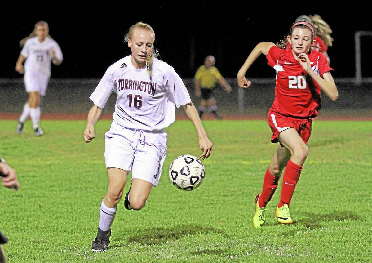 Torrington's Paige Middleton dribbles up the field in her team's 4-0 win over Wolcott.