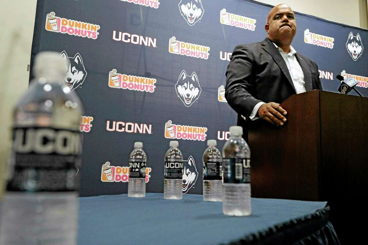 UConn Athletic Director Warde Manuel speaks at a news conference after the dismissal of Connecticut football coach Paul Pasqualoni on Monday.