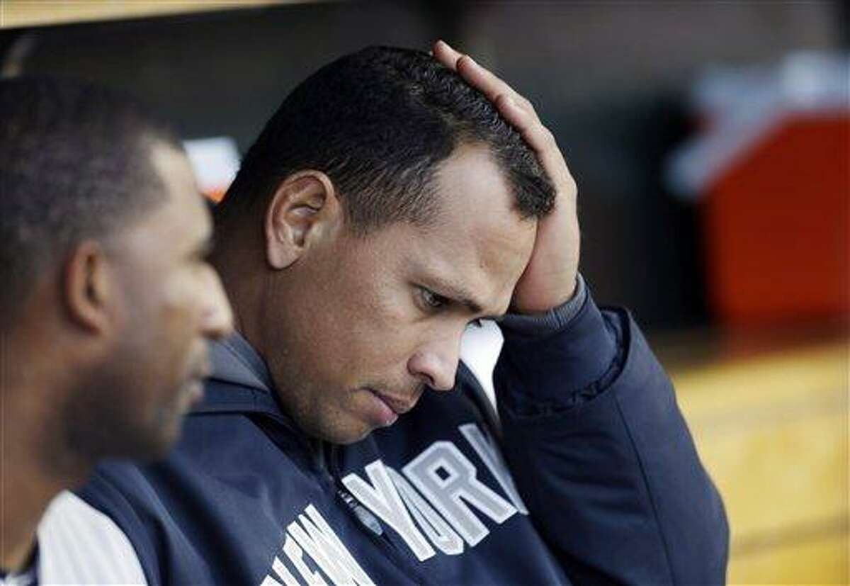 FILE - In this Oct. 18, 2012, file photo, New York Yankees' Alex Rodriguez watches from the dugout during Game 4 of the American League championship series against the Detroit Tigers in Detroit. Yankees general manager Brian Cashman says it's possible that third baseman Alex Rodriguez could miss the entire season while coming off hip surgery. He made his remarks Friday on WFAN radio in New York. (AP Photo/Paul Sancya, File)