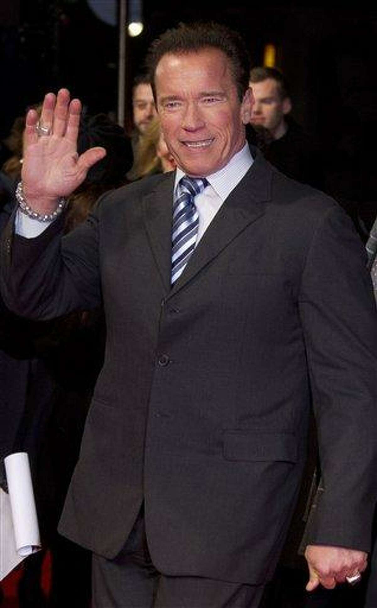 Arnold Schwarzenegger waves as he arrives for the European Premiere of The Last Stand at a central London cinema in Leicester Square, Tuesday, Jan. 22, 2013. (Photo by Joel Ryan/Invision/AP)