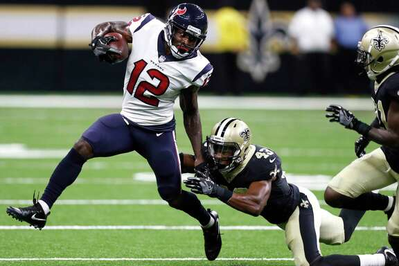 Houston Texans wide receiver Bruce Ellington (12) runs outside as he is hit by New Orleans Saints safety Marcus Williams (43) during the first quarter of an NFL pre-season football game at the Mercedes-Benz Superdome  on Saturday, Aug. 26, 2017, in New Orleans. ( Brett Coomer / Houston Chronicle )