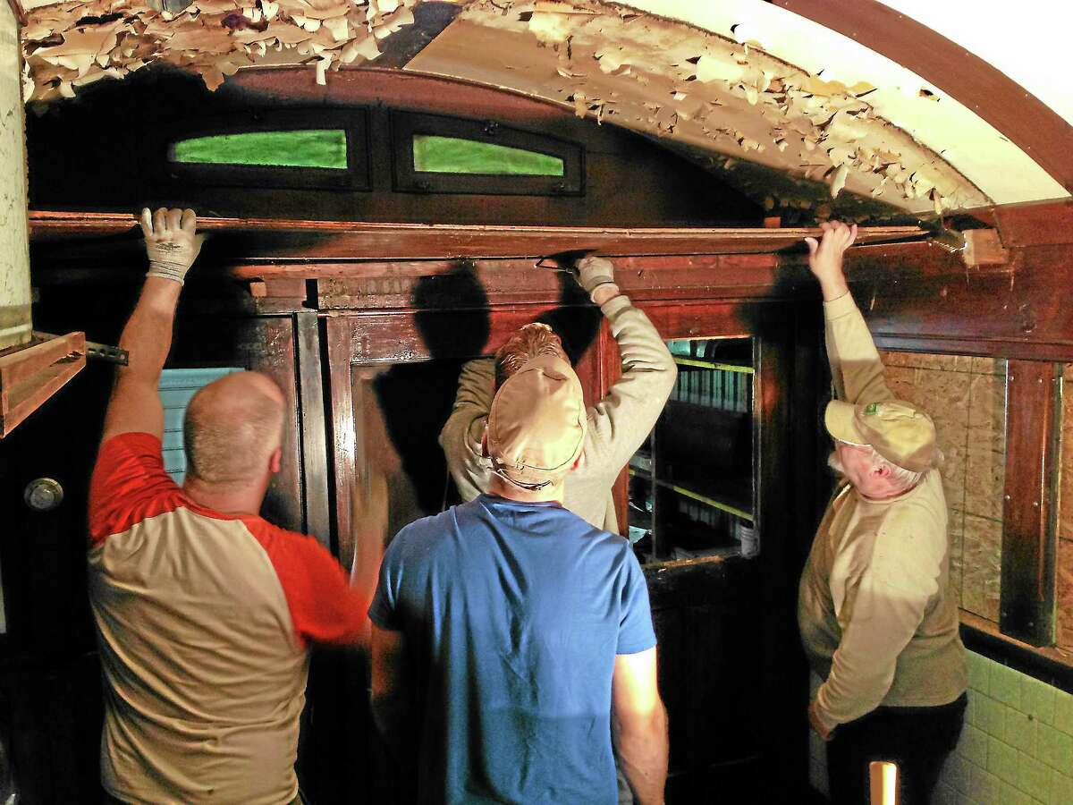 Volunteers work to restore the inside of the historic Skee's Diner, which the Torrington Historic Preservation Trust plans to install back in the city once renovations are complete.