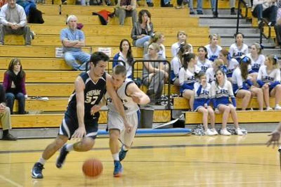 Litchfield's Tyler Mowry stealing the ball from Shepaug Valley's Kellen Rikhoff. Pete Paguaga/Register Citizen