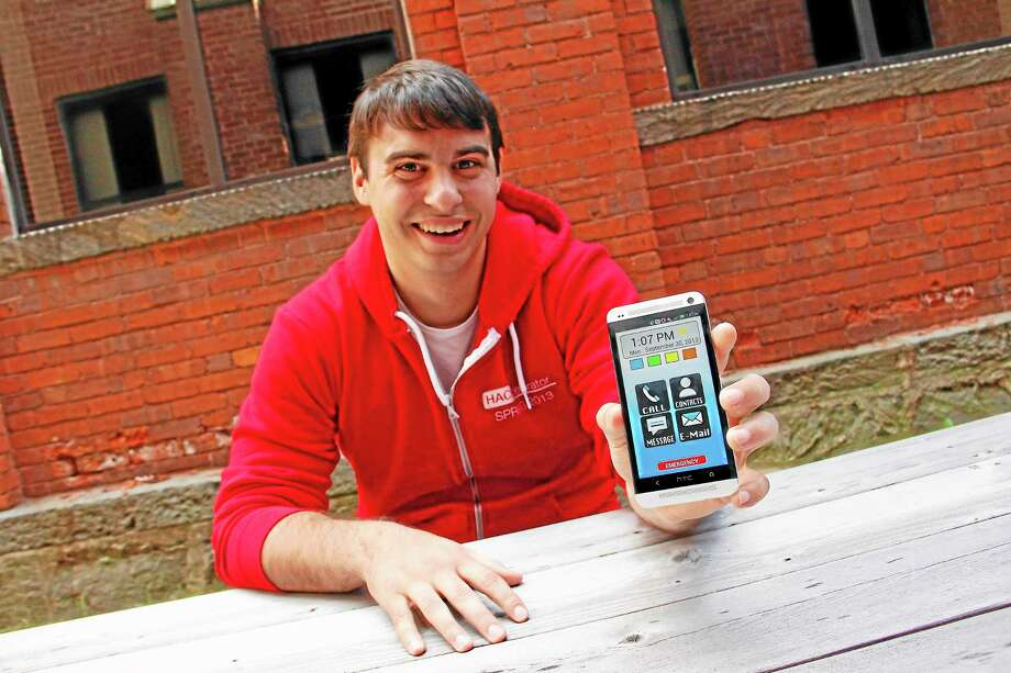 Michael Parrotta, a 2008 Torrington High School Graduate, holds up a smartphone with EasyLaunch, a phone app he his helping market, on Monday, Sept. 30. Parrotta is part of a three-member company called Blu Rush Media made up of Connecticut high school grads that developed EasyLaunch and create other applications for smartphones. Photo: Esteban L. Hernandez—Register Citizen