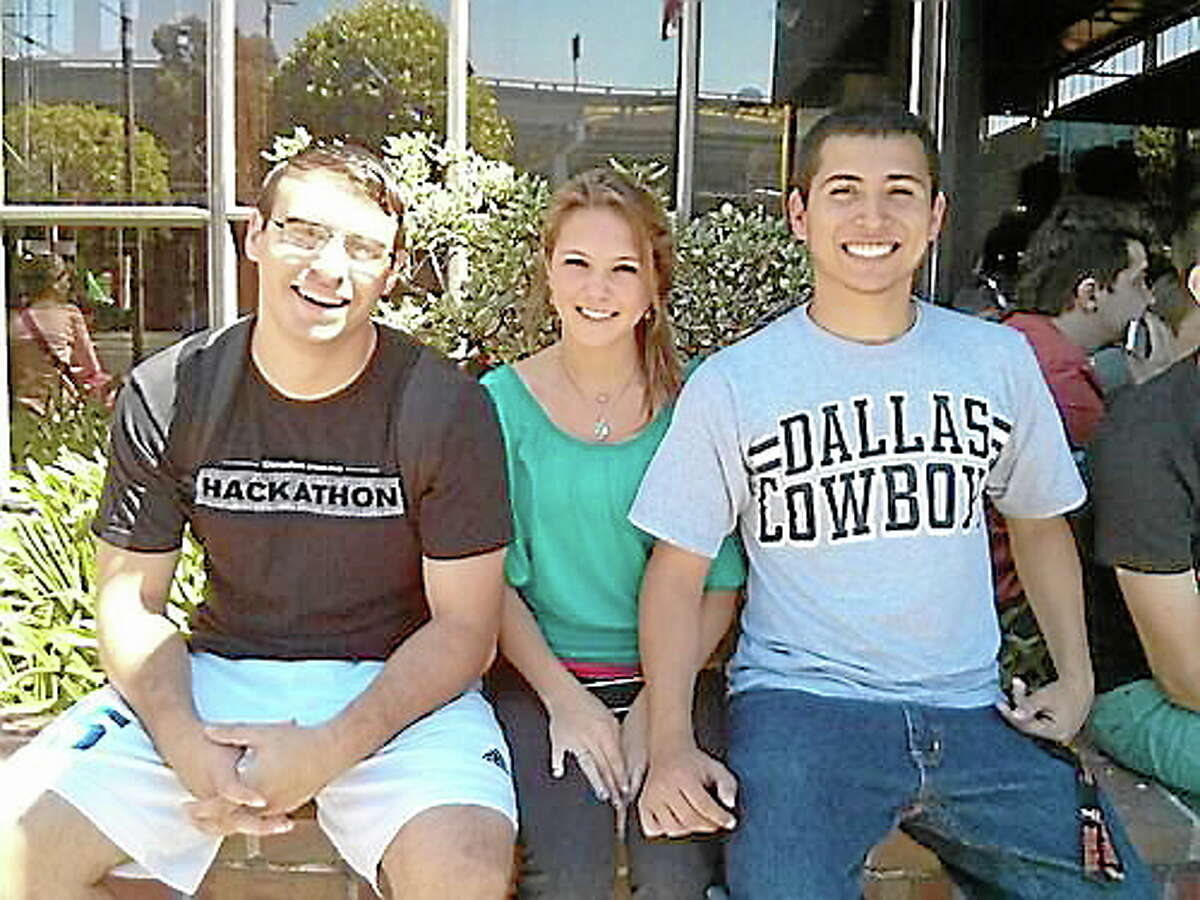 From left: Michael Parrotta, 22, Katy Morris, 20, and Derrick Franco, 21, members of Blu Rush media, which developed an app called EasyLaunch during a recent hackathon.