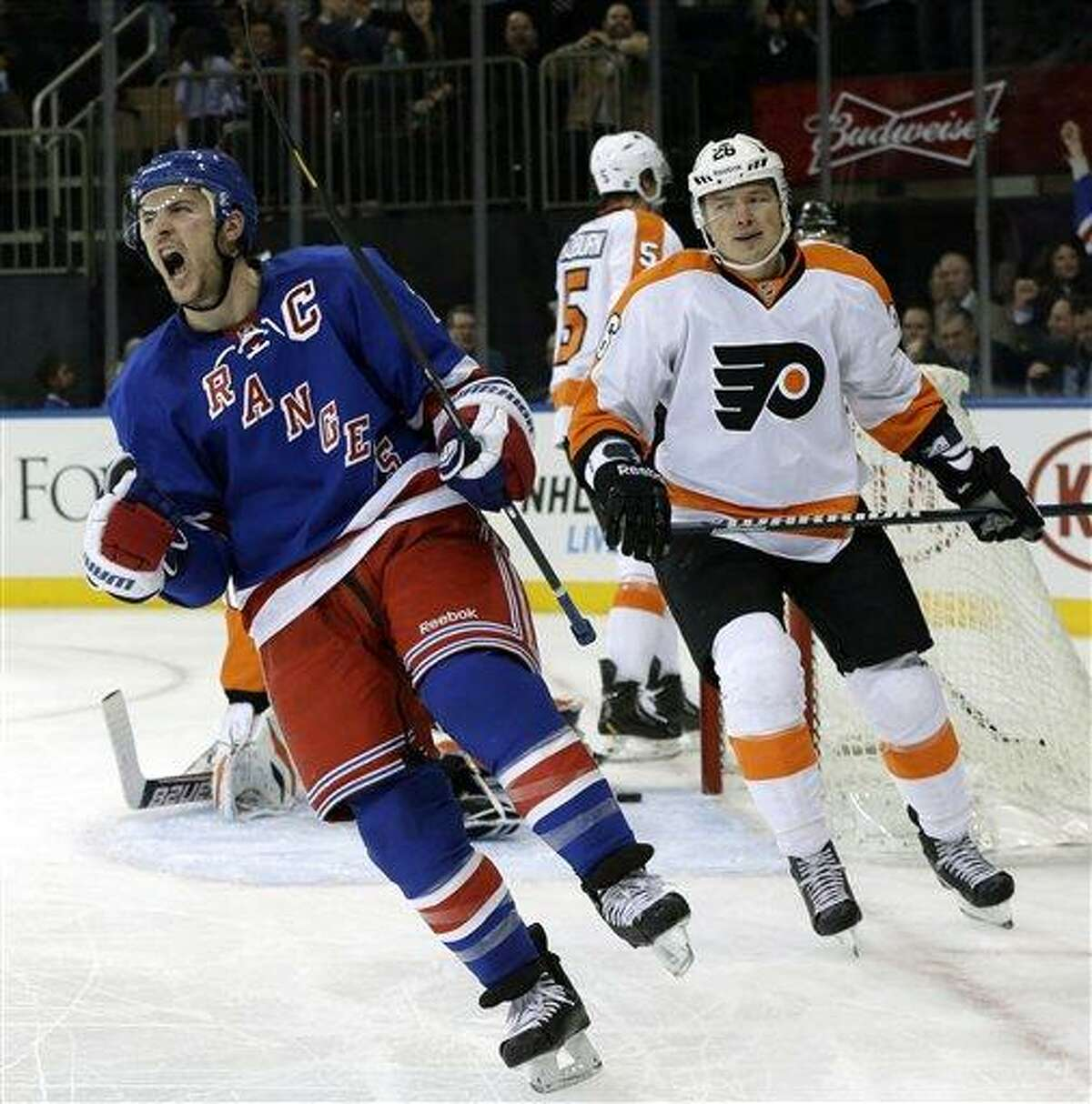 Philadelphia Flyers left wing Ruslan Fedotenko (26), of Ukraine, watches as New York Rangers right wing and captain Ryan Callahan (24) reacts after scoring a goal in the second period of their NHL hockey game at Madison Square Garden in New York, Tuesday, Jan. 29, 2013. (AP Photo/Kathy Willens)
