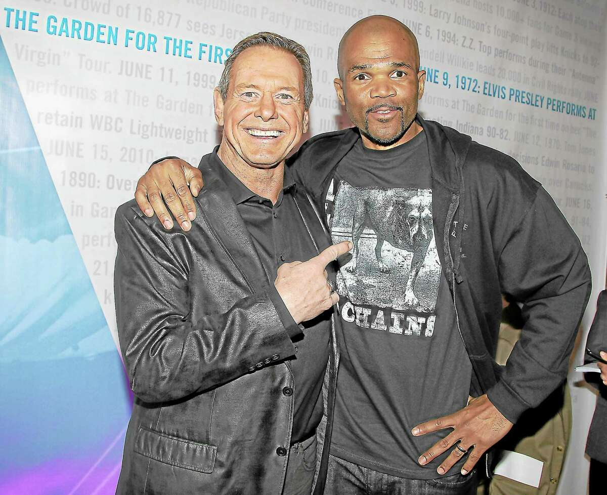 "This image released by Starpix shows wrestler ""Rowdy"" Roddy Piper, left, and Darryl McDaniels of Run DMC at the unveiling of the ""Garden 366"" exhibit at Madison Square Park, Thursday, Oct. 11, 2012 in New York."