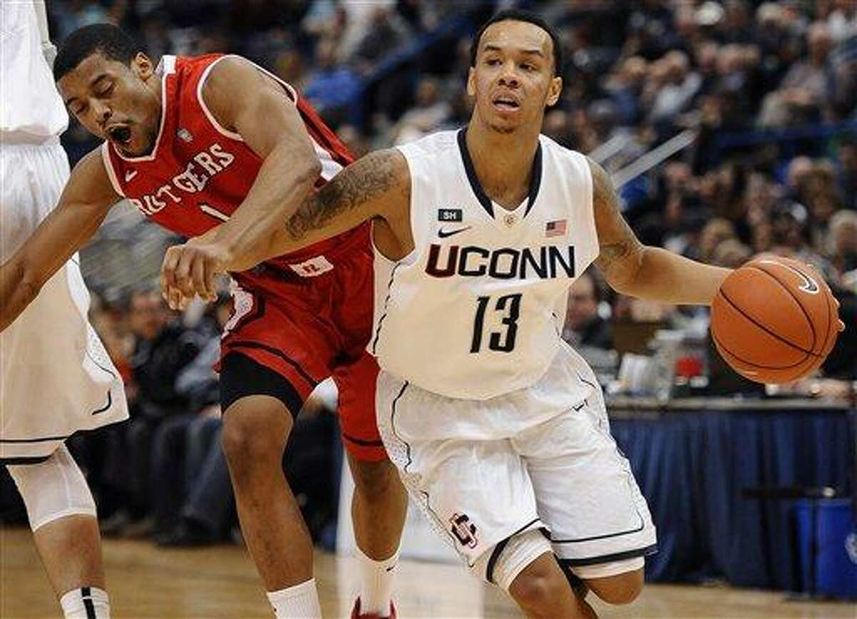 Connecticut's Shabazz Napier (13) drives past Rutgers' Jerome Seagears during the second half of an NCAA college basketball game in Hartford, Conn., Sunday, Jan. 27, 2013. Napier and Seagears were top scorers for their teams with 19 and 21 points respectively. Connecticut won 66-54. (AP Photo/Jessica Hill)