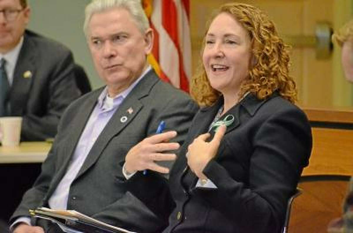 John Berry/Register Citizen U.S. Rep. Elizabeth Esty, right, with Litchfield First Selectmen Leo Paul, speaks with residents during a roundtable discussion in Torrington on gun violence prevention.