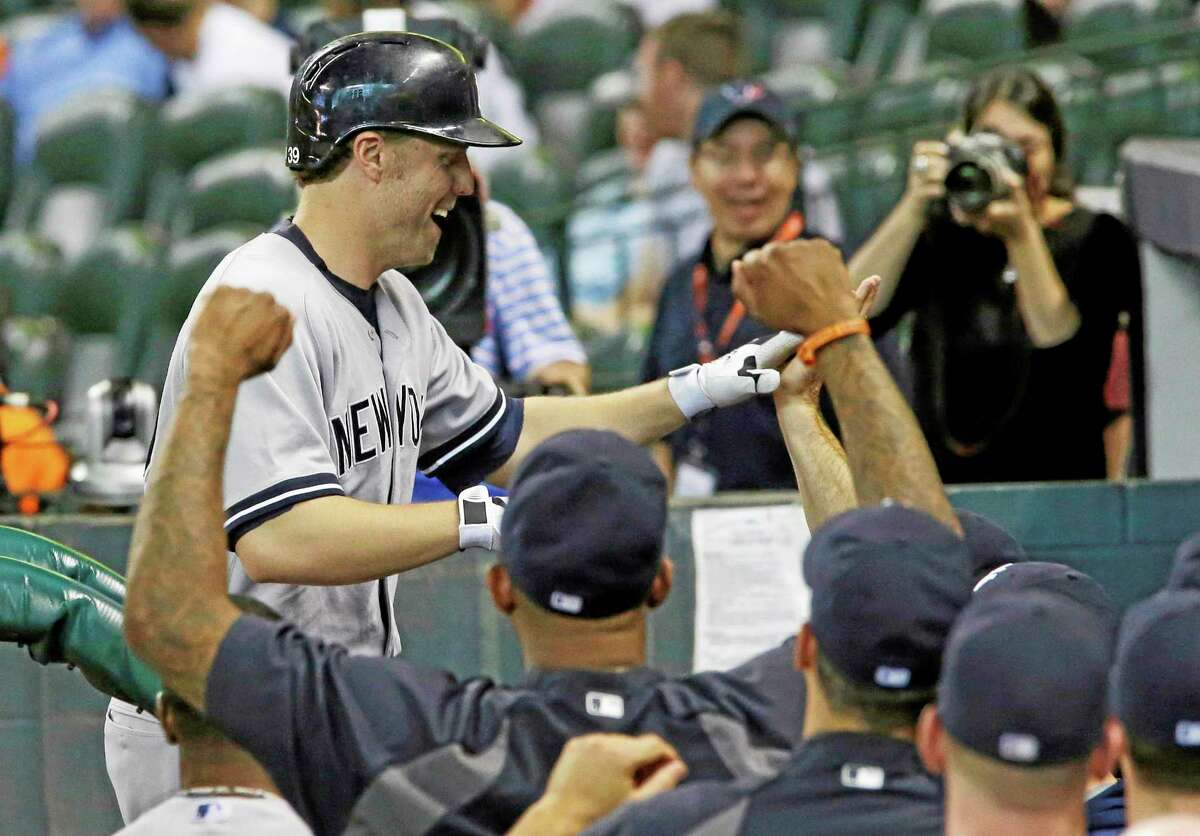 Mark Reynolds is greeted by teammates after his solo home run in the 14th inning against the Houston Astros Sunday.