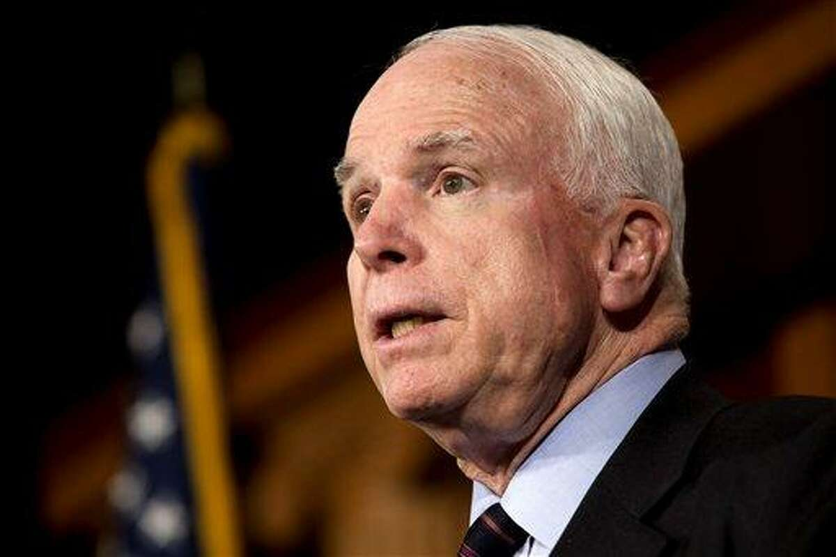 Sen. John McCain, R-Ariz., speaks about taking action in Syria, during a news conference on Capitol Hill in Washington, Thursday, Dec. 6, 2012. (AP Photo/Jacquelyn Martin)