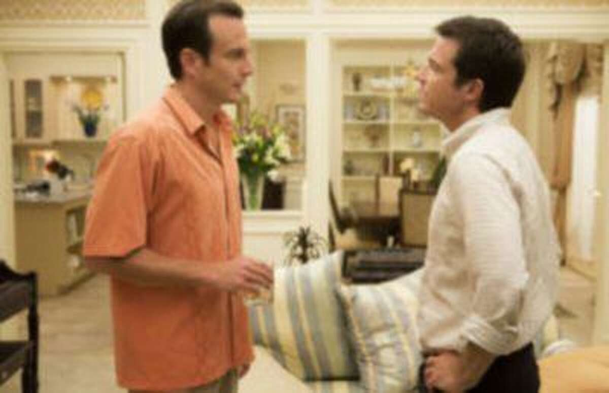 This undated publicity photo released by Netflix shows Will Arnett, left, and Jason Bateman in a scene from