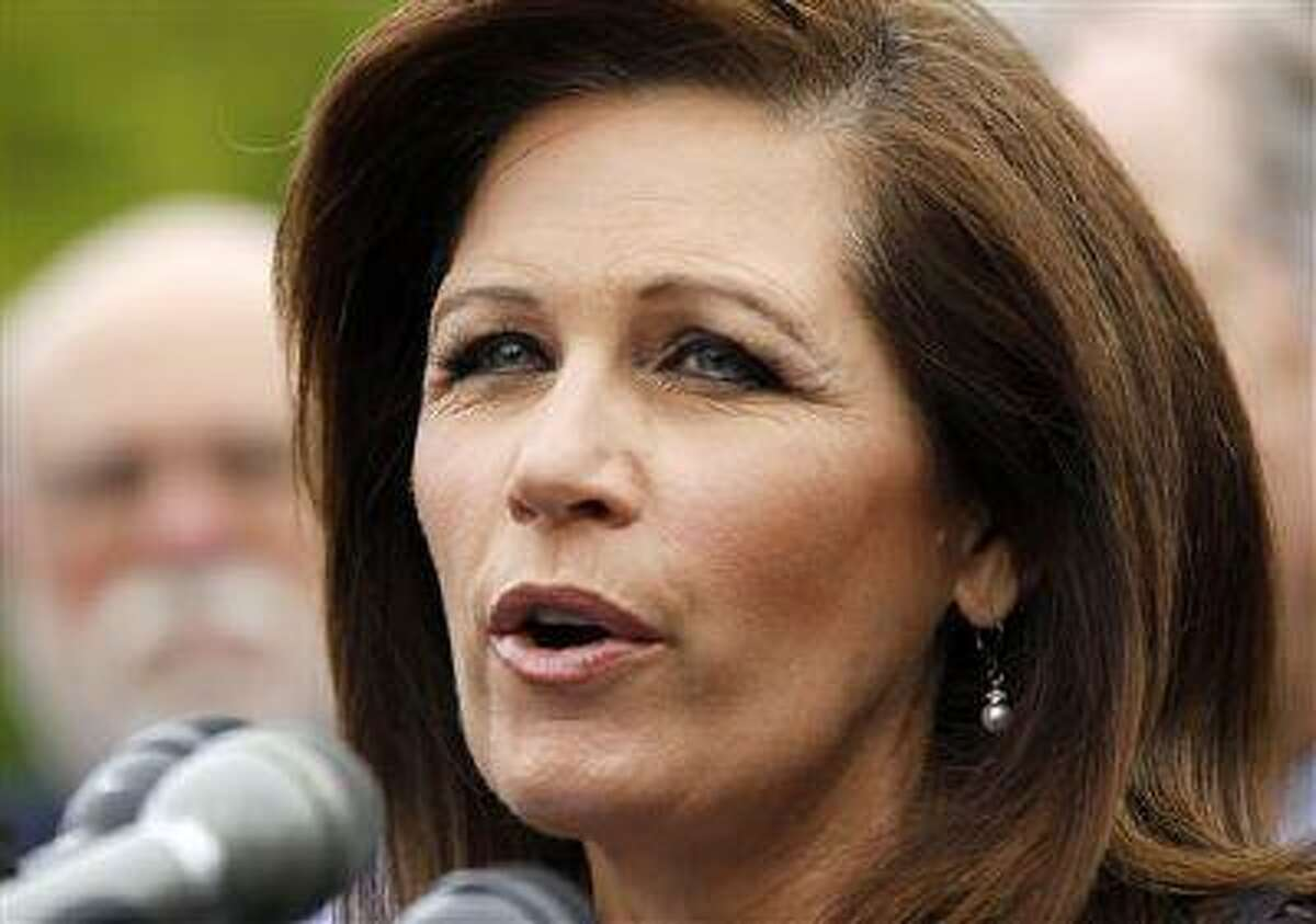 Rep. Michele Bachmann, R-Minn. chair of the Tea Party Caucus speaks on Capitol Hill in Washington, Thursday, May 16, 2013, during a news conference with Tea Party leaders to discuss the IRS targeting Tea Party groups. (AP Photo/Molly Riley)