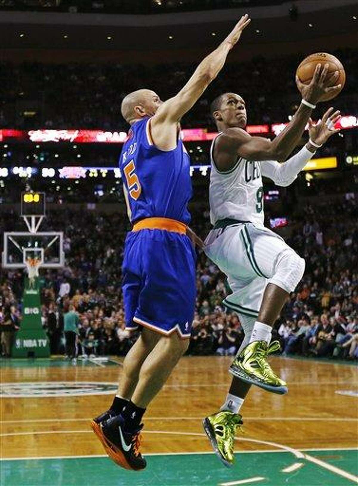Boston Celtics guard Rajon Rondo, right, drives to the basket against New York Knicks guard Jason Kidd during the second quarter of an NBA basketball game in Boston, Thursday, Jan. 24, 2013. (AP Photo/Charles Krupa)