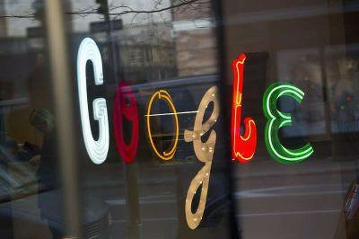 The Google signage is seen at the company's headquarters in New York January 8, 2013.