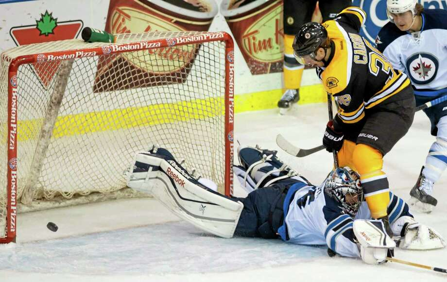 Bruins defenseman Zdeno Chara puts the puck past Winnipeg Jets goalie Al Montoya for a goal during the second period of a preseason game Friday in Saskatoon, Saskatchewan. Photo: Liam Richards — The Associated Press  / The Canadian Press