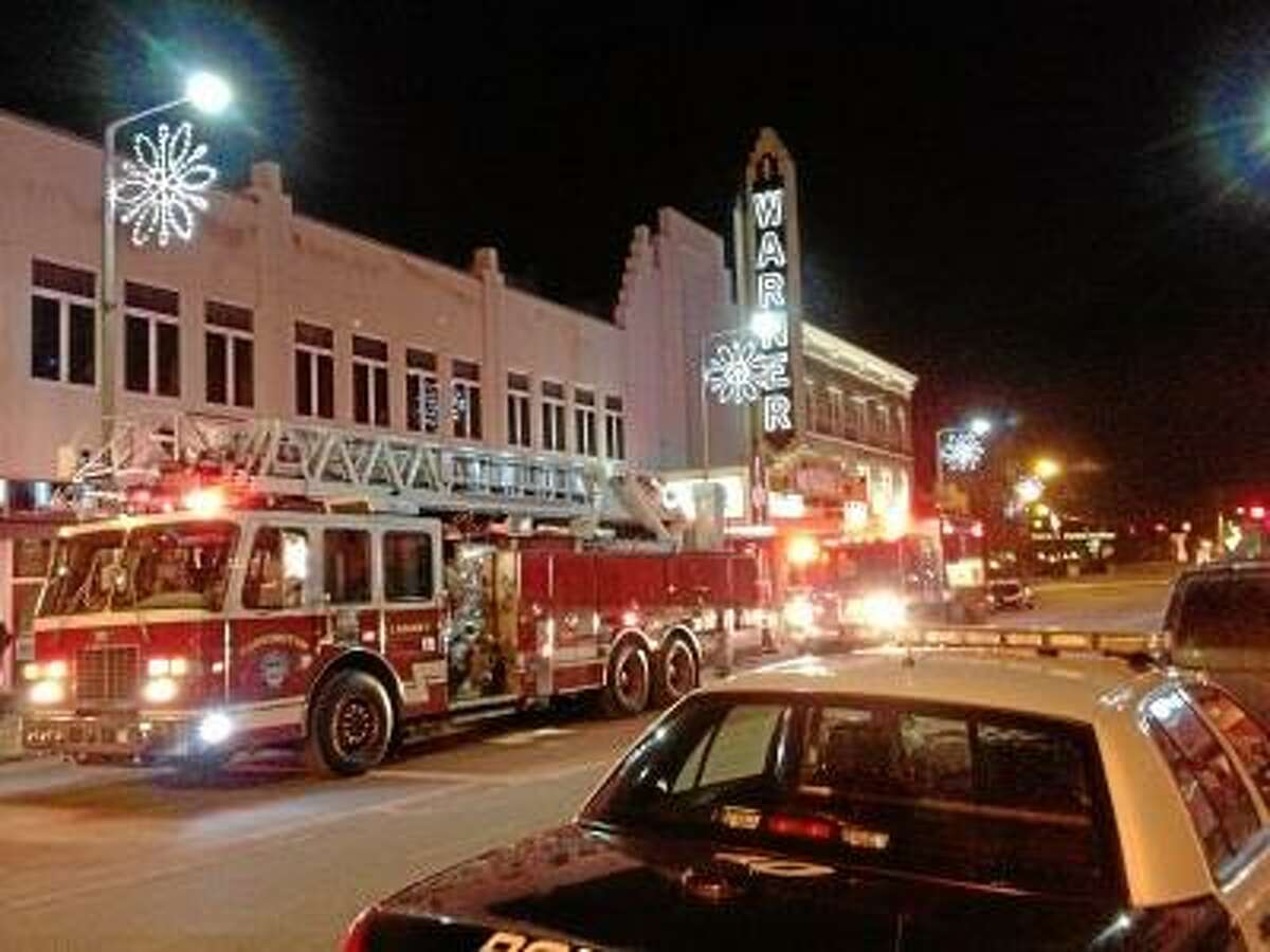 Photo by John Berry/Register Citizen Torrington police and firefighters responded to the Warner Theatre late Sunday night after receiving a call about possible flooding and the odor of smoke. No fire was found, but a sprinkler pipe burst, flooding an area between the main stage and the studio theater.