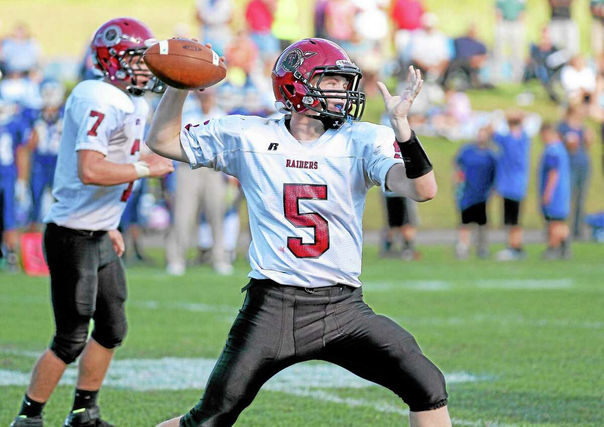 Connor Finn throws a pass during Torrington's 52-37 loss to St. Paul. Finn threw for 238-yards and four touchdown passes.