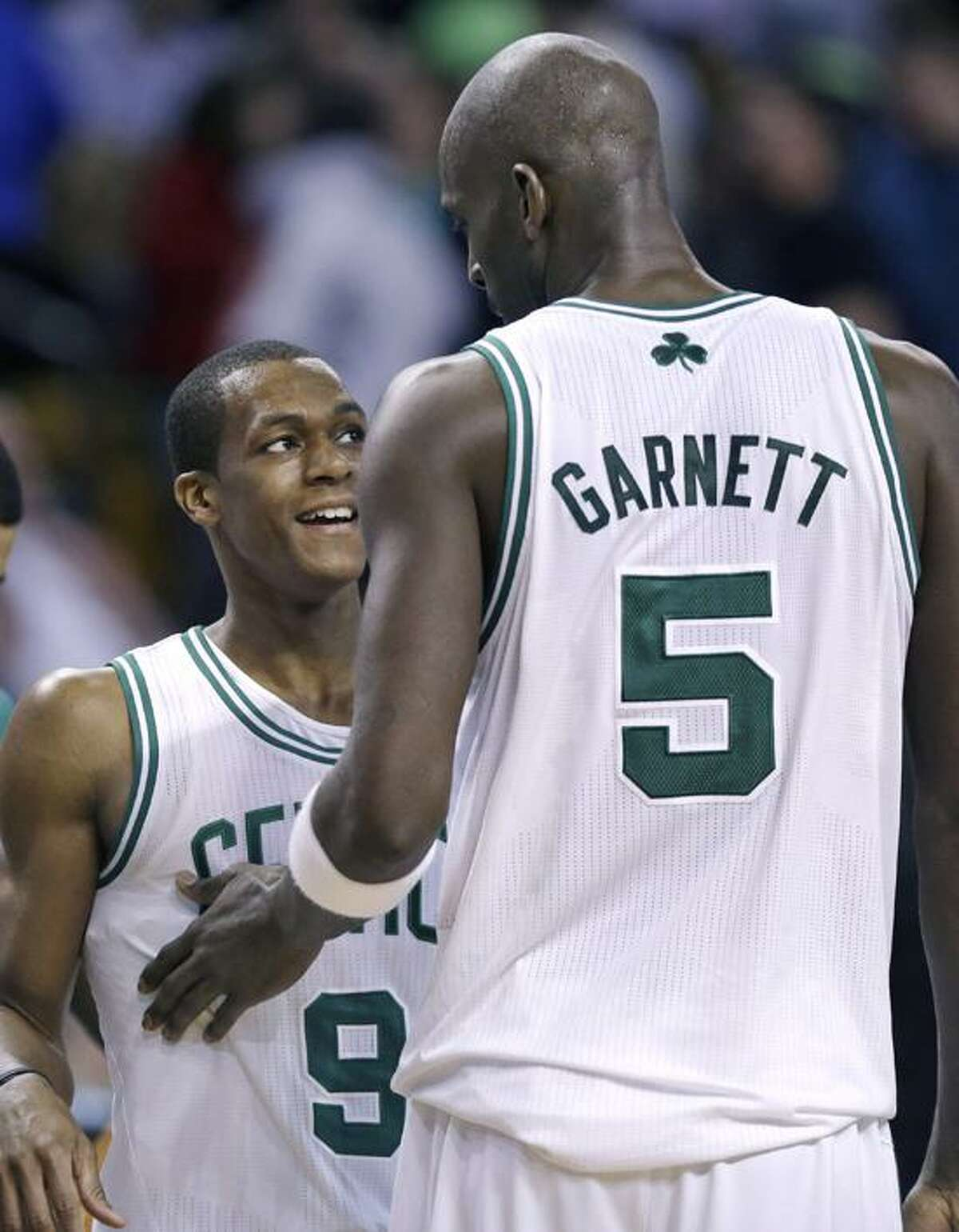 Boston Celtics forward Kevin Garnett (5) pats guard Rajon Rondo (9) on the chest near the end of an NBA basketball game against the Phoenix Suns in Boston, Wednesday, Jan. 9, 2013. The Celtics won 87-79. (AP Photo/Elise Amendola)