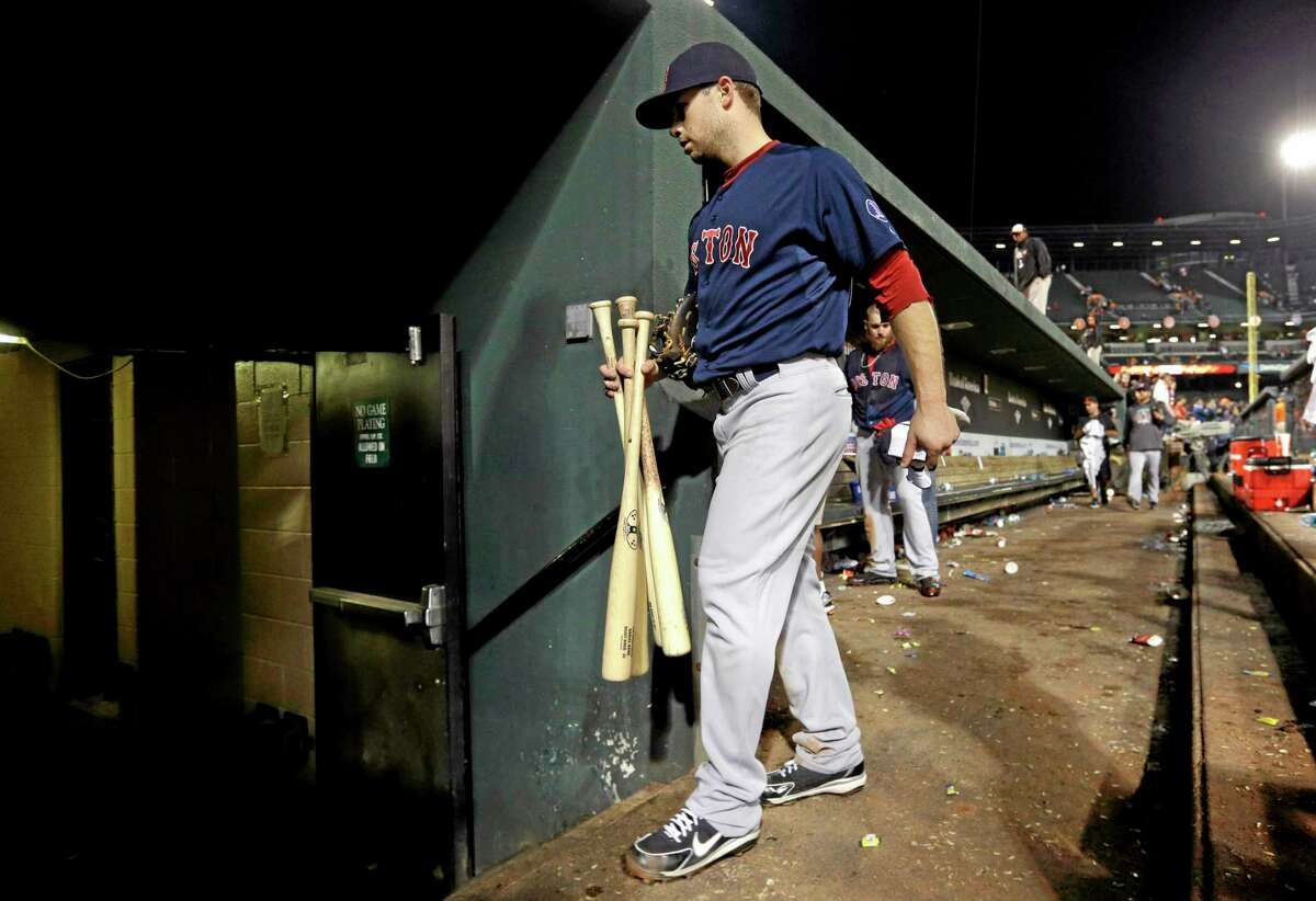 Boston's Daniel Nava walks out of the dugout after Saturday's game against the Baltimore Orioles.