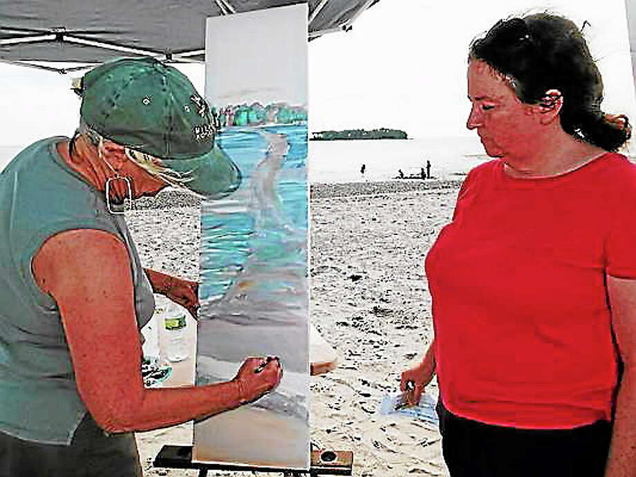 Steve Johnson/Submitted photo Milford artist Elizabeth B. Wright, left, finds Silver Sands State Park in Milford a good place to paint, while Maryann Kling looks on. Photo: Journal Register Co.