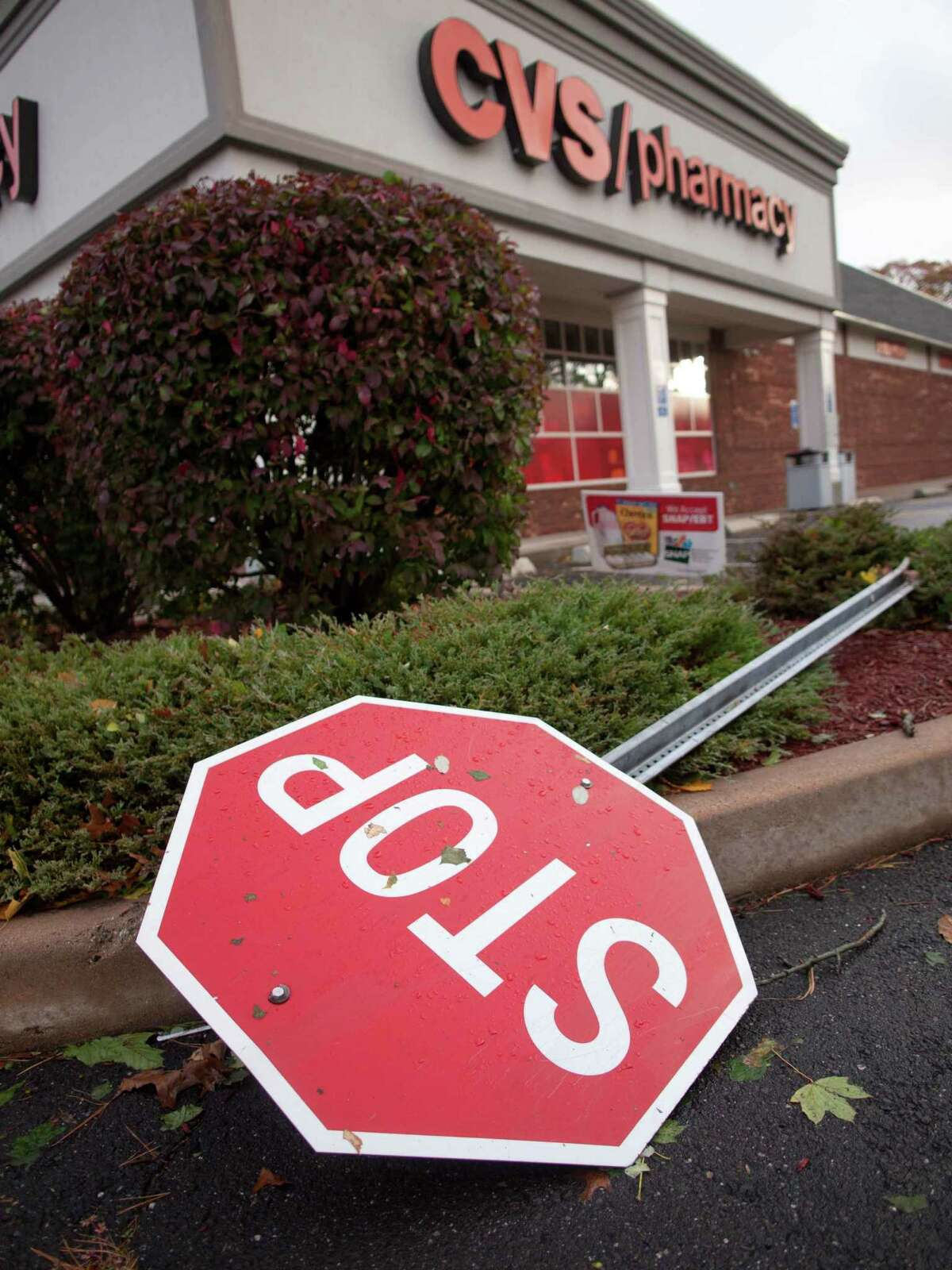 A stop sign knocked over at the Rt 1 CVS in Branford knocked down during the height of Hurricane Sandy October 30, 2012. vm williams
