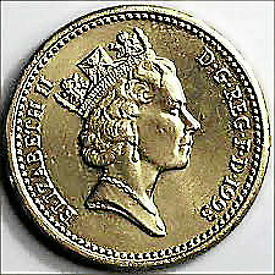 A coin worth 1 pound currently honors Prince George's great-grandmother, Queen Elizabeth II. Photo: Journal Register Co.
