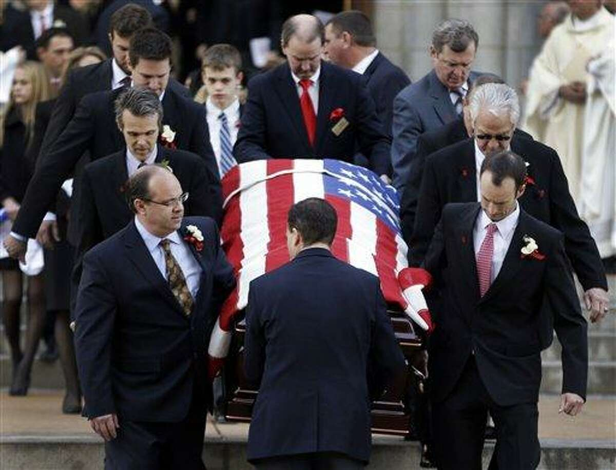 Pallbearers carry the casket containing the body of former St. Louis Cardinals baseball player Stan Musial out of the Cathedral Basilica of Saint Louis following his funeral Mass, Saturday, Jan. 26, 2013, in St. Louis. Musial, one of baseball's greatest hitters and a Hall of Famer with the Cardinals for more than two decades, died Saturday, Jan. 19. He was 92. (AP Photo/Jeff Roberson)