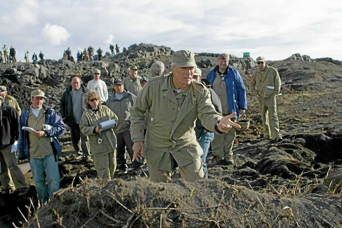 US actor Clint Eastwood, centre, and crew members film on location for the 2006 film Flags of our Fathers, in the Reykjanes Peninsula, Iceland. Iceland is turning to Hollywood for much needed revenue and jobs, as well as a touch of glamour, as it struggles to recover from a nationwide banking and currency collapse.