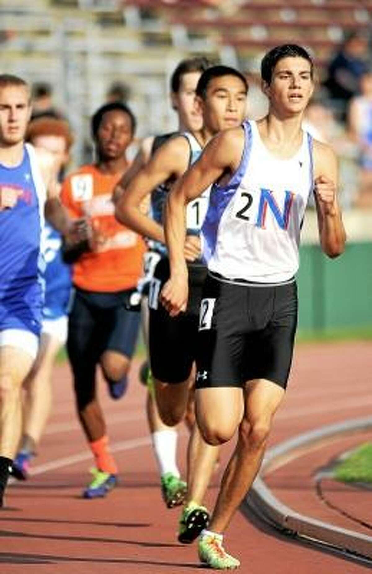 Nonnewaug senior Jonah Riolo races to first in the 800-meter run in Wednesday's Class M Track & Field Championship at Willow Brook Park in New Britain. Photo by Catherine Avalone/The Middletown Press