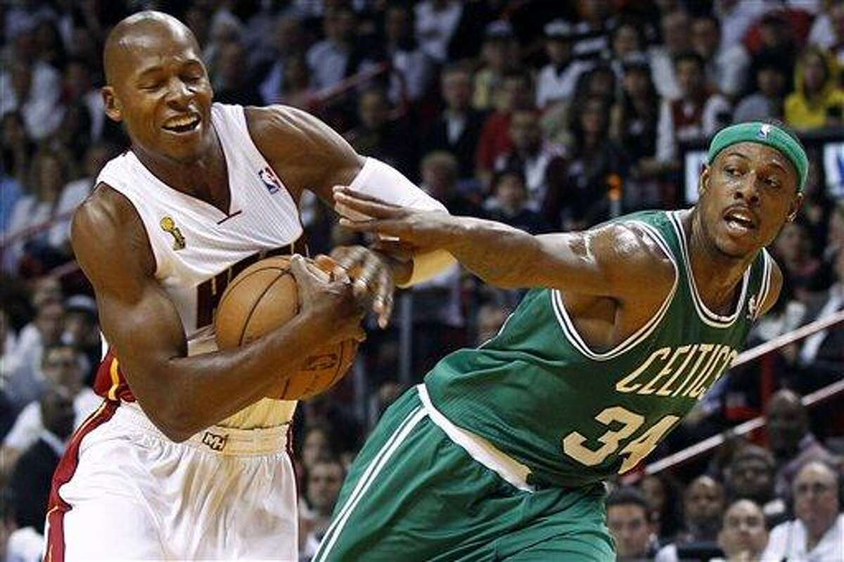 Boston Celtics' Paul Pierce (34) fouls Miami Heat's Ray Allen, left, during the first half of an NBA basketball game, Tuesday, Oct. 30, 2012, in Miami. (AP Photo/J Pat Carter)