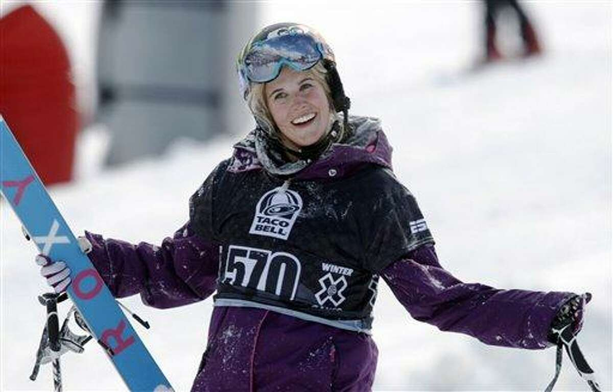 FILE - In a Jan. 28, 2010, file photo, Sarah Burke, of Canada, reacts after failing to place in the top-three finishers in the slopestyle skiing women's final at the Winter X Games at Buttermilk Mountain outside Aspen, Colo. It's been just over a year since the Canadian freestyle icon's death following a training accident on a halfpipe in Utah. Her friends still half expect her name to be called at Winter X Games and for her to drop in for an amazing run. (AP Photo/David Zalubowski, File)