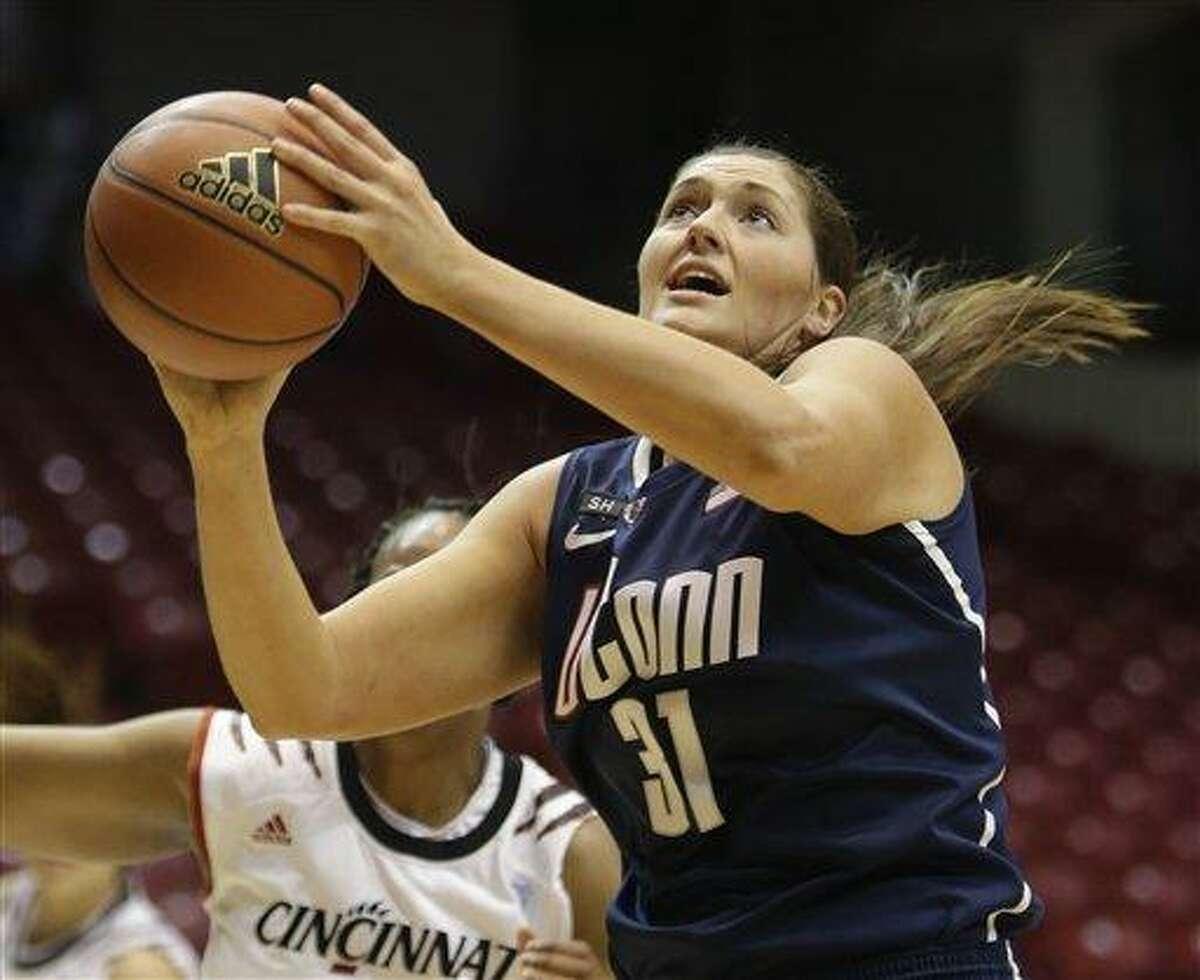 Connecticut center Stefanie Dolson (31) in action against Cincinnati in an NCAA college basketball game, Saturday, Jan. 26, 2013 in Cincinnati. Dolson scored 15 points to lead Connecticut to a 67-31 win. (AP Photo/Al Behrman)