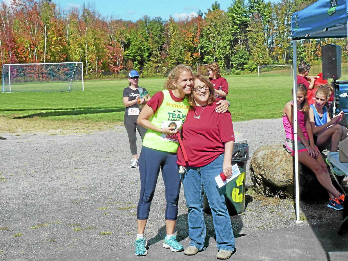 Ryan Flynn - Register CitizenMichaela Clary had the women's top time and was awarded with a medal and a $25 gift certificate to Sportsmen's in Bantam.