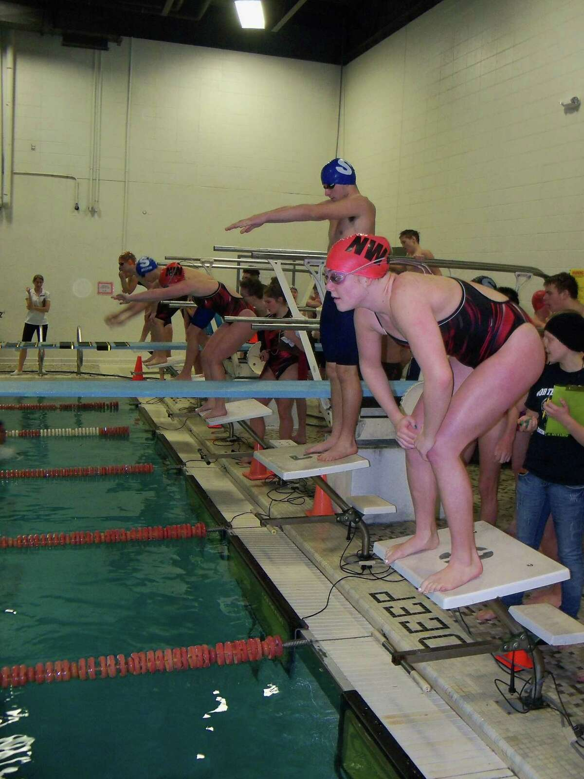 Swimmers of Northwestern and Shepaug Valley get set for a match in Winsted. Photo by Peter Wallace/Register Citizen